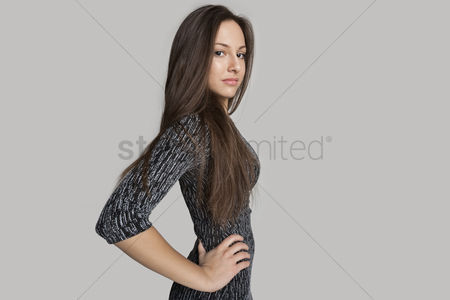 Black background : Side view portrait of confident girl against gray background