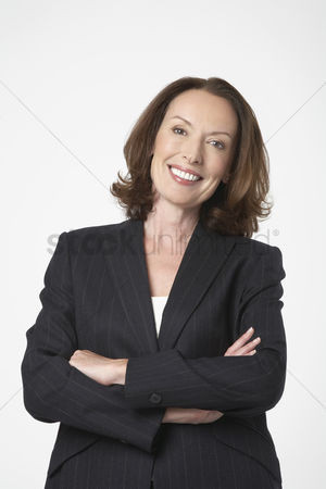 White hair : Smiling businesswoman standing with arms crossed