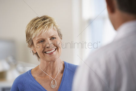 Two people : Smiling woman in office