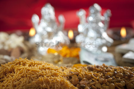 God : Snacks with idols of lakshmi and ganesh during diwali festival