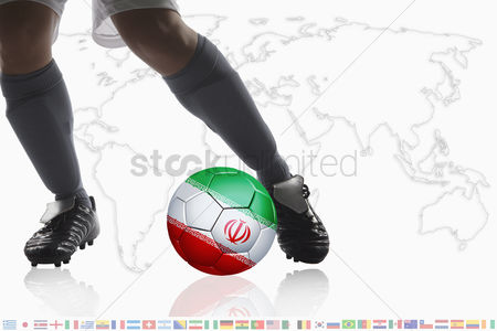 Iran : Soccer player dribble a soccer ball with iran flag