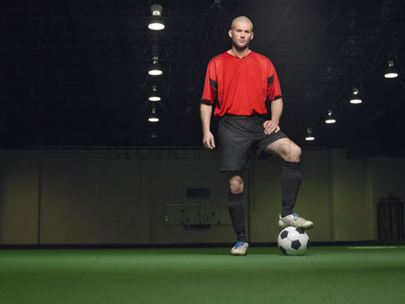 Bald : Soccer player standing on ball portrait