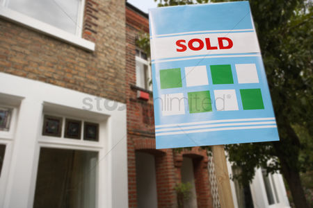First : Sold sign in front of house