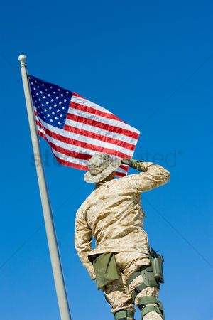 Us : Soldier saluting united states flag outdoors  low angle view