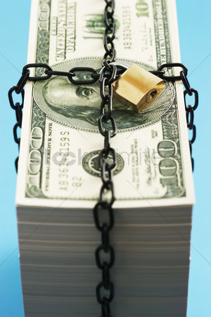 Pile : Stack of dollars secured by padlock and chain