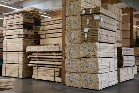 Pile : Stacks of plywood piled up in warehouse