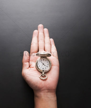 Conceptual : Stopwatch on a palm