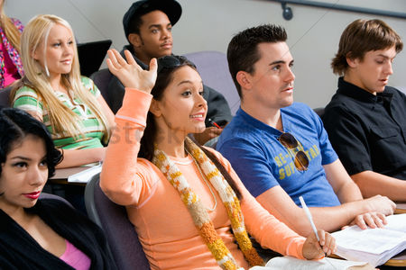 High school : Student raising hand during class lecture
