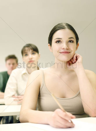 College : Students paying attention in class