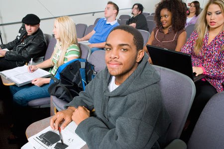 Young boy : Students sitting in lecture hall