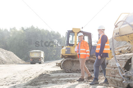Supervisor : Supervisors walking at construction site against clear sky