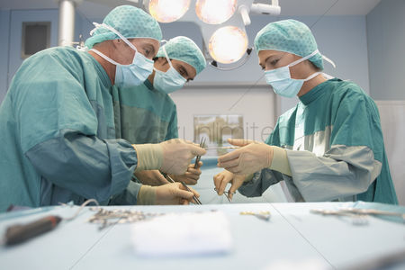 Head shot : Surgeons in operating room