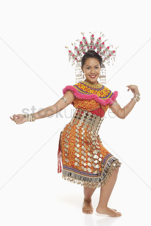 Bidayuh ethnicity : Talented woman in an iban traditional clothing dancing