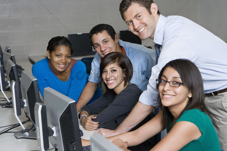 School : Teacher and students in computer lab