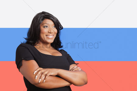 Respect : Thoughtful casual mixed race woman over russian flag