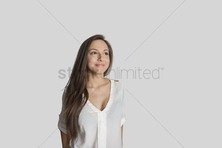 Teenager : Thoughtful teenage girl against gray background
