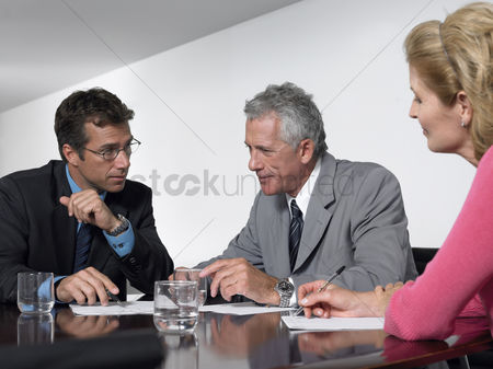 Leadership : Three business colleagues in conference meeting