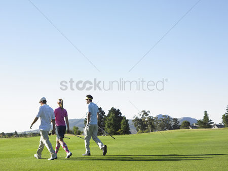 Women group outside : Three golfers on course