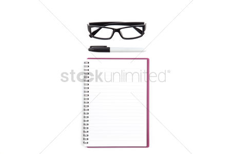 School : Top view of notebook and spectacles on white background with copyspace