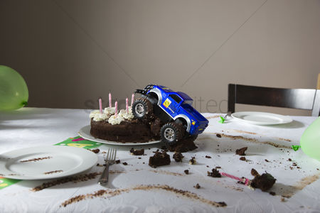 Toy : Toy car driven into birthday cake