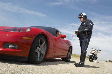 Land : Traffic cop talking with driver of sports car