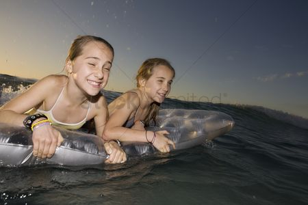 Funny : Twin sisters wave surfing on airbed