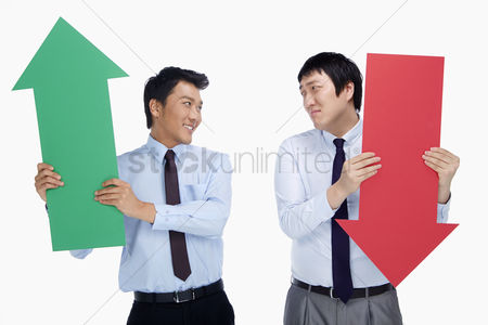Two people : Two businessmen holding up an arrow