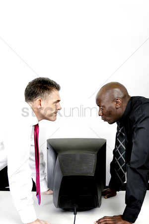 Fury : Two businessmen staring at each other angrily