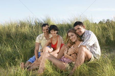 Women group outside : Two couples relaxing on dunes