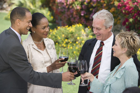 Toasting : Two couples toasting outdoors