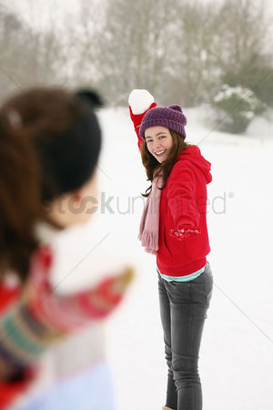 Gladness : Two girls playing with snowballs