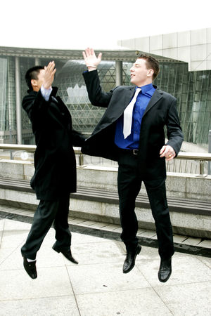 Excited : Two men in business suit giving high five