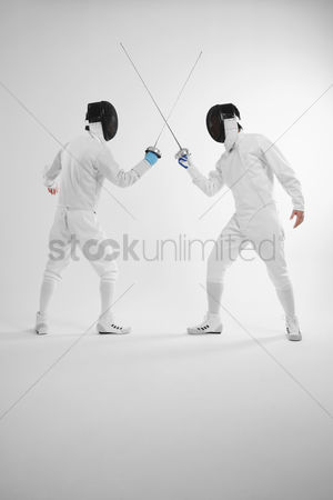 Fight : Two men in fencing suits in a duel