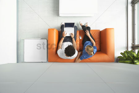 Furniture : Two people using laptop in reception room view from above