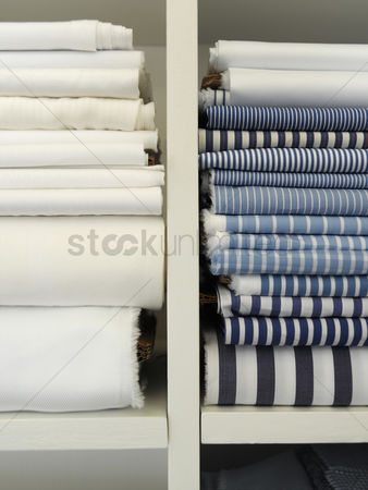 Pile : Two piles of cotton towels on shelf