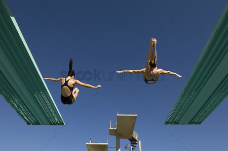 Diving : Two women diving from diving board