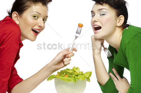 Friend : Two women eating salad