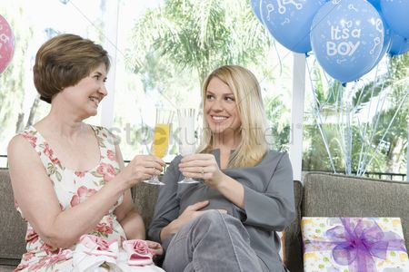 Toasting : Two women toasting drinks at a baby shower