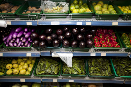 Supermarket : Variety of fruits and vegetables on display in grocery store