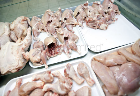 Supermarket : Variety of raw chicken pieces in tray at store