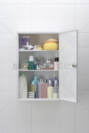 Medication : Various cosmetics and bath products in bathroom cabinet