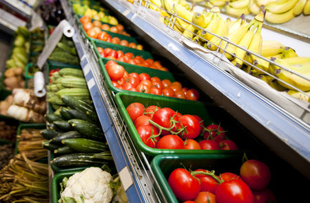 Business : Various vegetables and fruits on display in supermarket