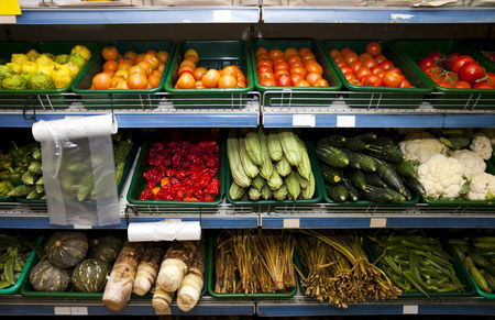 Variety : Various vegetables on shelves in grocery store