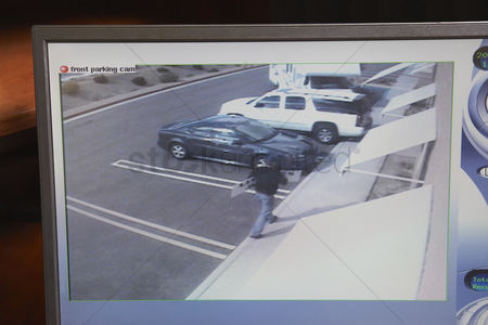 Thief : Video monitor with picture from security camera