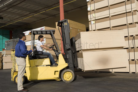 Forklift : Warehouseman and forklift truck driver