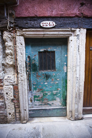 Weathered : Weathered doorway of a house  venice  veneto  italy