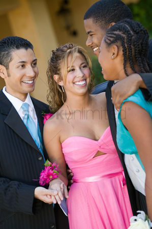 Dance : Well-dressed teenage couples talking outside