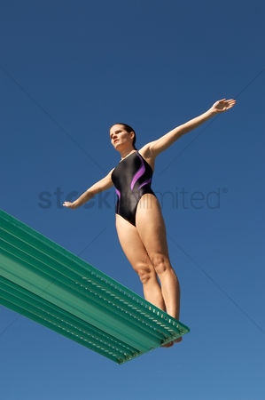 Diving : Woman about to dive backwards off a diving board