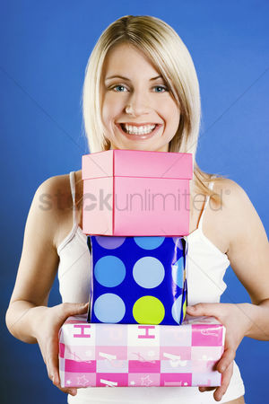Celebrating : Woman carrying a stack of presents