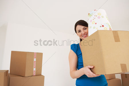 First : Woman carrying cardboard box